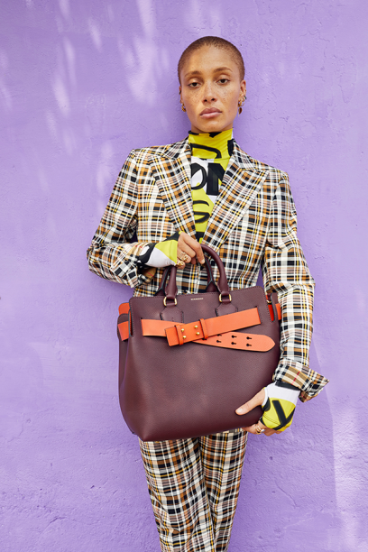 Adwoa-Aboah-in-a-graffiti-print-bodysuit-and-tailored-check-suit-and-carrying-The-medium-Belt-Bag-c-Courtesy-of-Burberry_Juergen-Teller