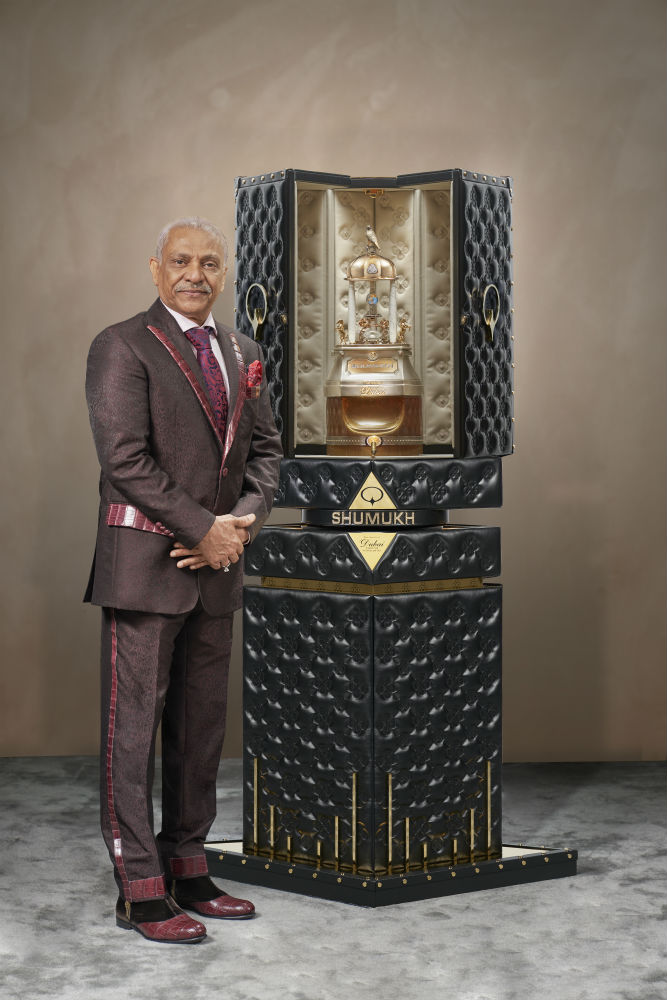 The chairman of the perfumers poses with world's most expensive perfume