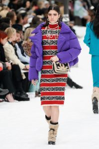Colour came in the form of red knitwear and bright purple jackets at Chanel's AW19 show