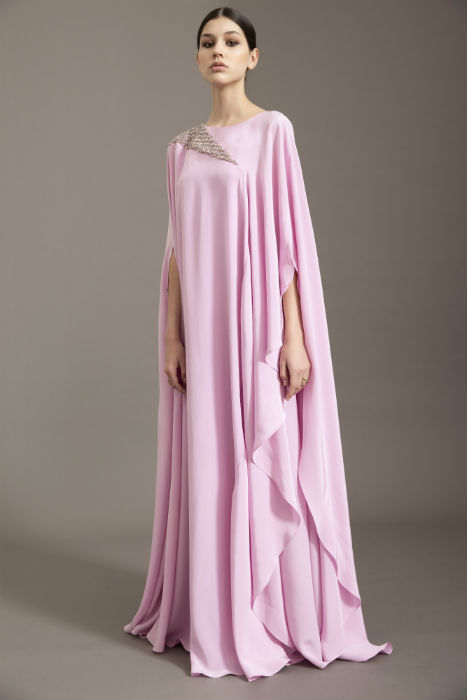 The pink kaftans represent the flowers surviving in the desert