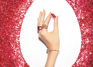 Fabergé Emotion and charmeuse holding ruby