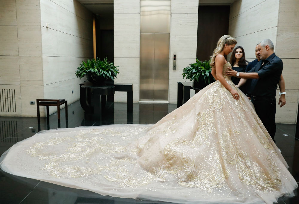 See more of Christina Mourad's Elie Saab wedding gown
