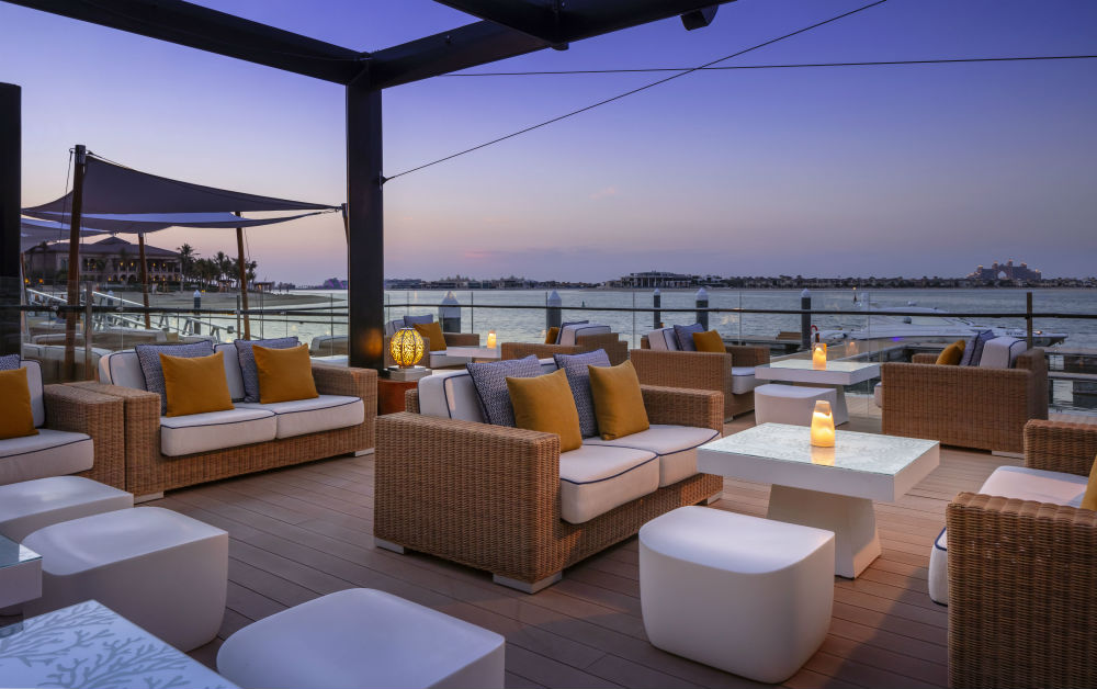 Terrace seating during sunset at One&Only The Palm