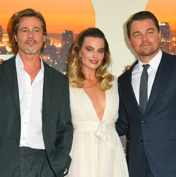 Margot Robbie with co-stars Brad Pitt and Leonardo DiCaprio side by side