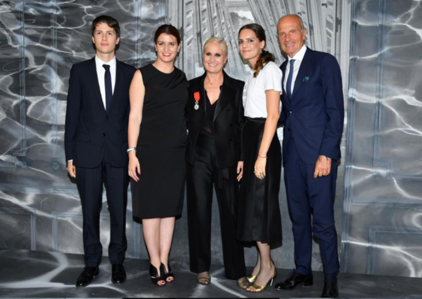 Maria Grazia Chiuri 's family joined her onstag as as she accepted her Legion D'honneur award