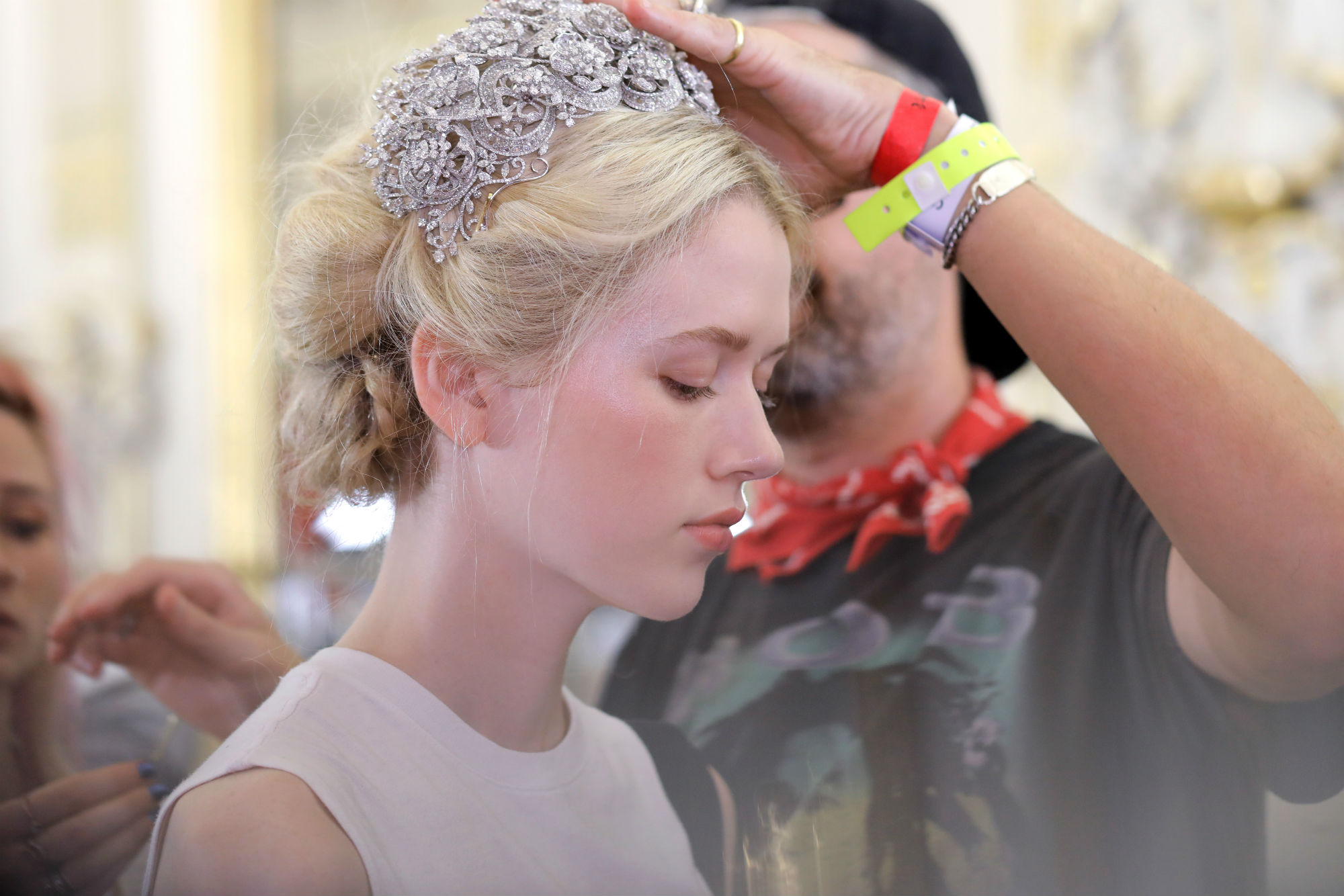 An intricate pearl hairstyle was created during the Ralph & Russo AW19 show