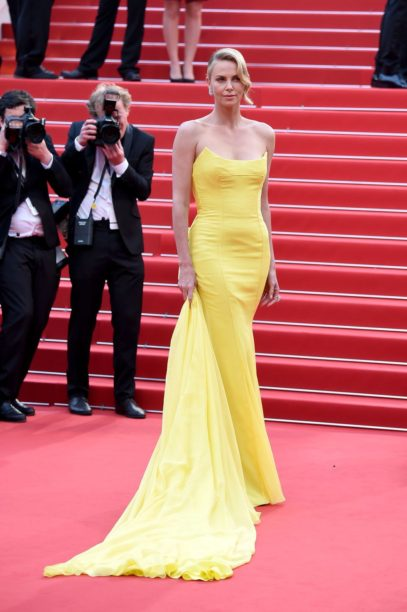 Charlize Theron wore Christian Dior.